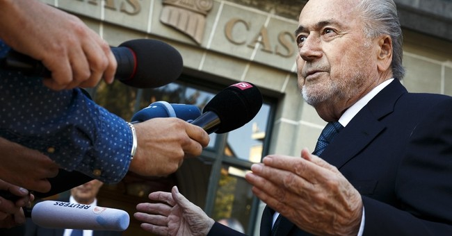 Blatter 'reckless' to pay Platini $2M, new court ruling says