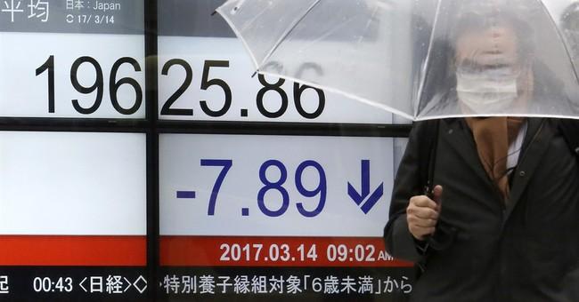 Asian stocks slip as investors await Fed's likely rate hike