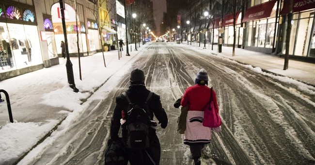 The Latest: Trains returning; cold threatens cherry blossoms