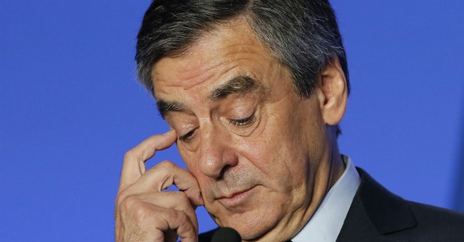 French presidential candidate Fillon charged in jobs probe