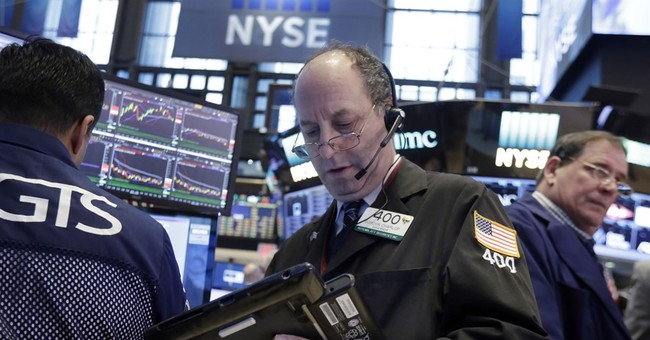 Global stocks push higher after Fed, Dutch election results