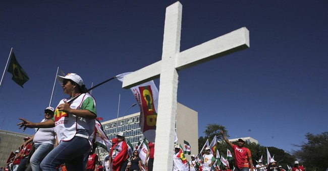 Brazilians demonstrate, strike to protest pension changes