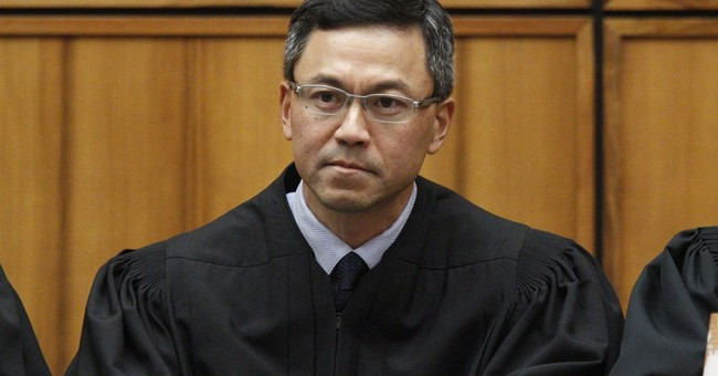 Native Hawaiian federal judge halts revised travel ban