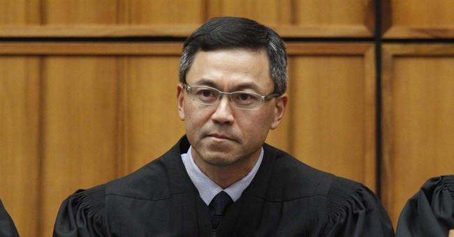 Native Hawaiian federal judge halts revised travel ban