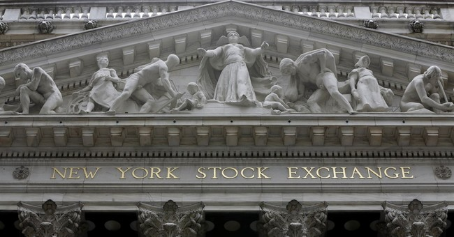 Asian markets mostly higher after Fed hike