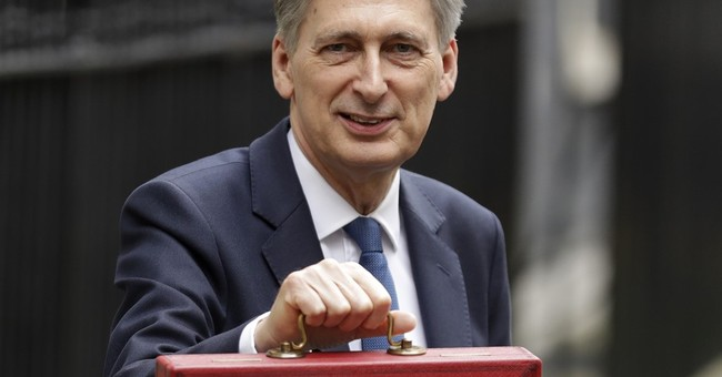 UK Treasury chief backs down on tax plans after outrage