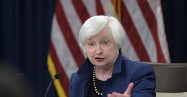 Fed raises rate and sees more hikes as US economy improves