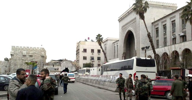 Suicide bombers strike Syrian capital as war enters 7th year