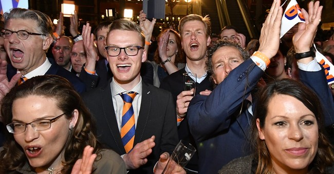 The Latest: French candidate Macron welcomes Dutch result