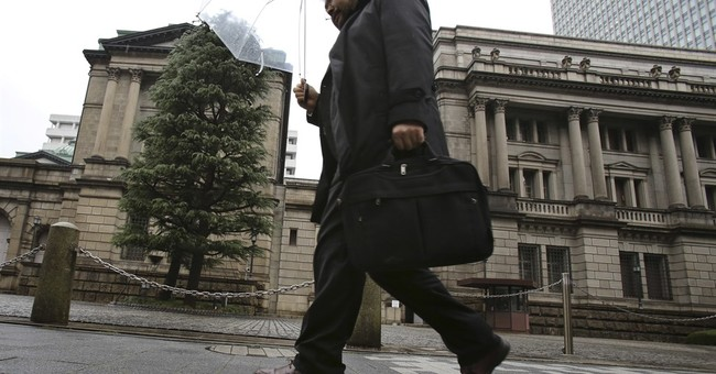 Japan's central bank holds steady on interest rate, stimulus