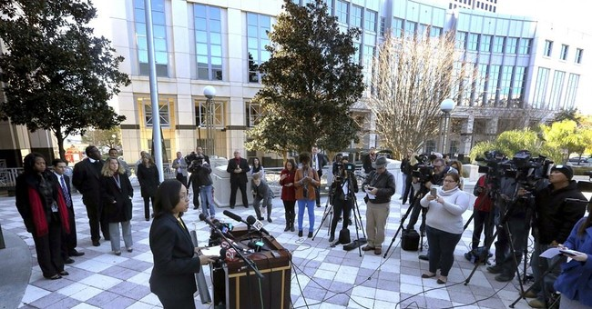 The Latest: Victim's mom supports prosecutor's decision