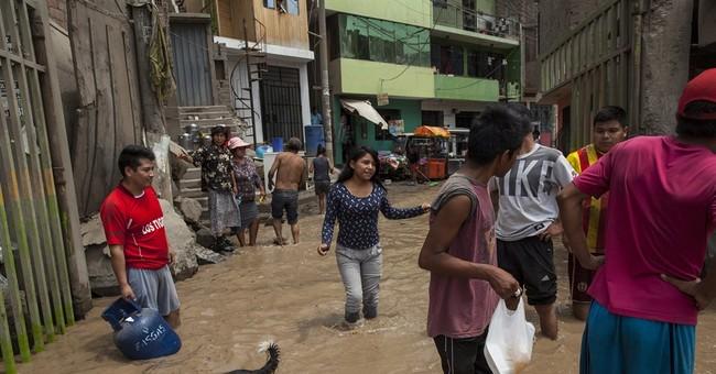 Dozen die in new round of flooding in Peru