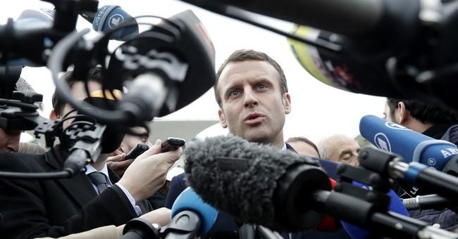 French presidential candidate Macron visits Berlin, Merkel