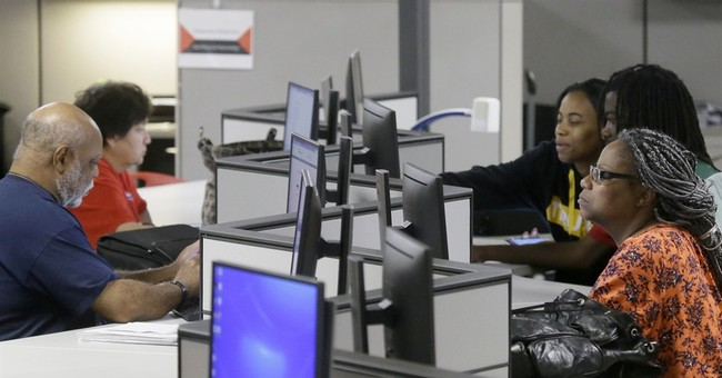 US claims for unemployment benefits slip by 2,000