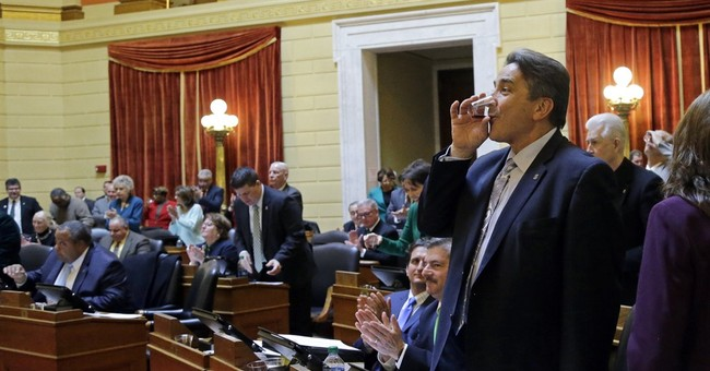 St. Patrick's toast held after fuss over lawmakers' drinking