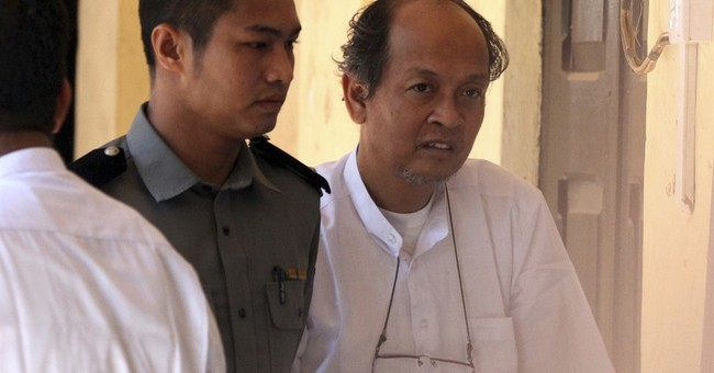 4 accused in killing of Suu Kyi adviser appear in court