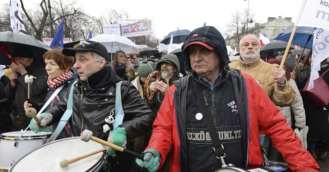 Poles protest govt policies ousting some mayors and judges