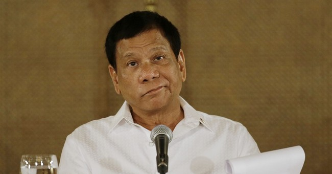 Duterte: Philippines can't stop China moves in disputed sea