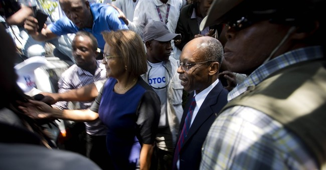 Lawyers: Attackers shoot at motorcade carrying Aristide