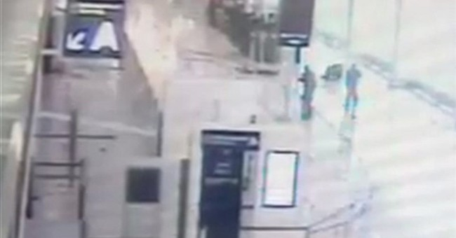AP Exclusive: Orly video shows attacker rushing soldier