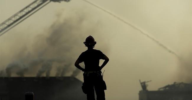 Suburban Kansas City apartment building fire ignites houses