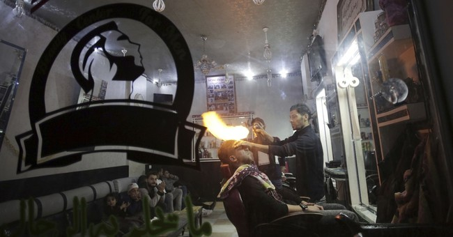 AP PHOTOS: Gaza Barber blazes hair styles with fiery method