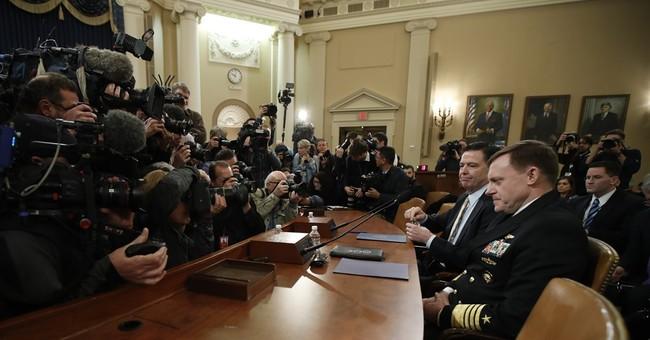 The Latest: Trump keeping tabs on Russia hearing, tweeting
