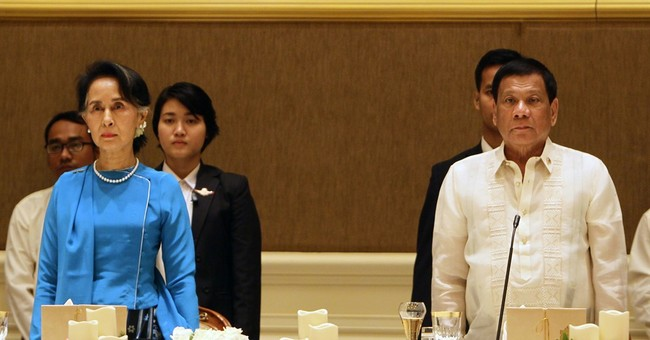 Contrast in style as Duterte meets Myanmar's Suu Kyi