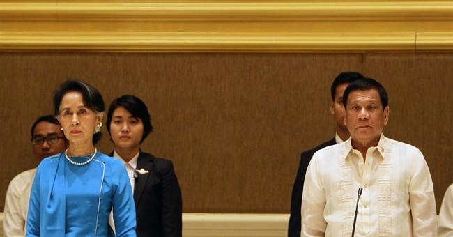 Contrast in style as Duterte meets Myanmar's Suu Kyi