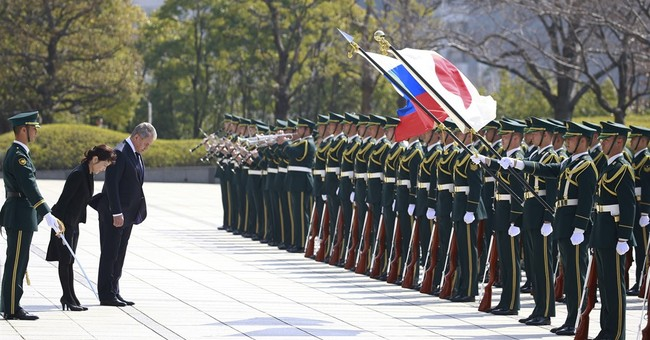 Japan, Russia bolster cooperation, urge NKorean restraint