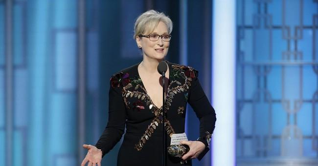 Streep wins Globe DeMille award, excoriates Trump