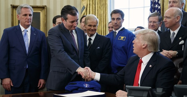 Trump signs NASA bill, ponders sending Congress to space