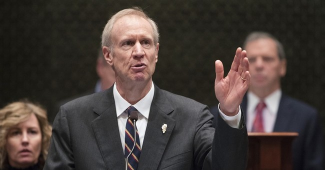 APNewsBreak: Illinois governor seeks prison tower cameras