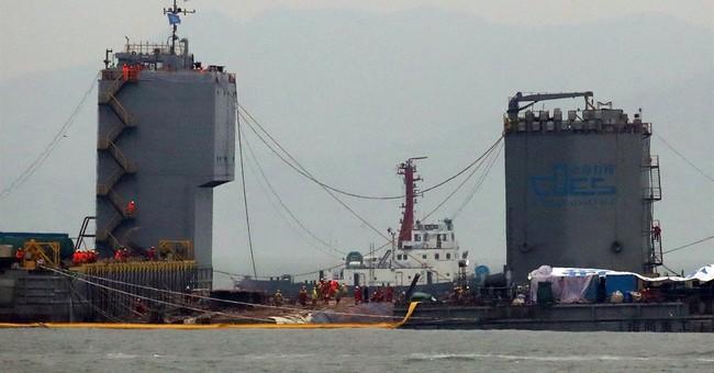 Sunken S.Korean ferry set to be loaded on transport vessel