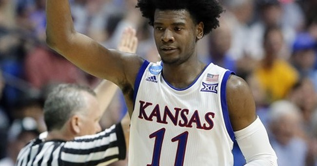 Jayhawks fans divided over on-court success, off-court woes