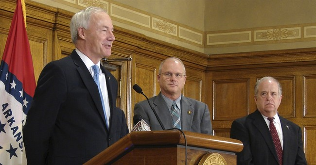 Arkansas governor expands where concealed guns allowed