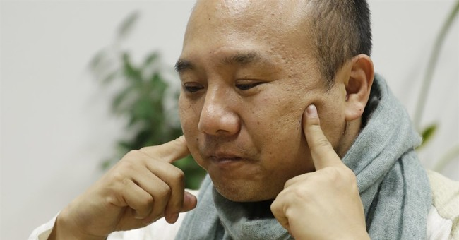 As Japan suicides drop, survivor shares story to save others