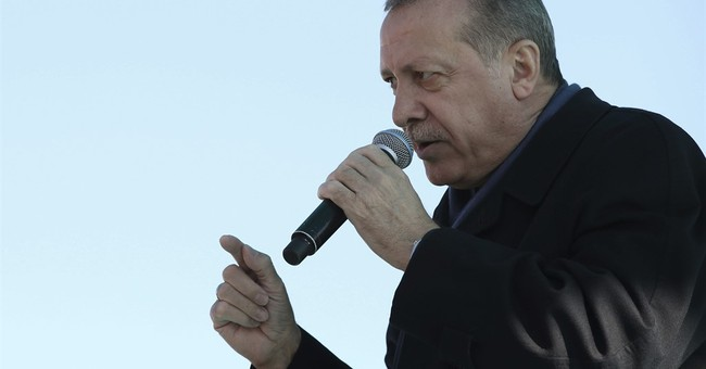 The Latest: Erdogan considers reviewing ties with the EU