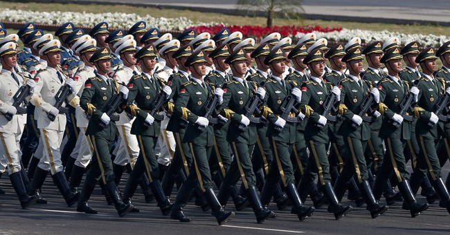 Pakistani president at military parade offers talks to India
