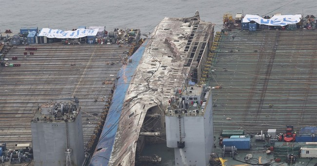 Corroded South Korean ferry loaded onto transport vessel