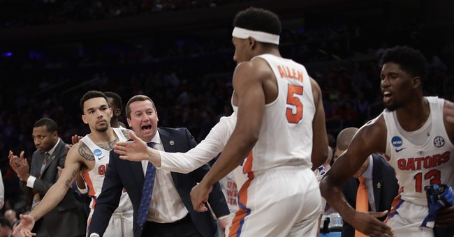 The Latest: Chiozza's 3 gives SEC an Elite Eight trio