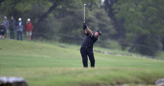 The Latest: Dustin Johnson powers way into round of 16
