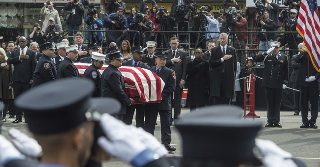 Mourners pack church, streets for medic struck by ambulance