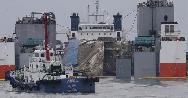 Recovering sunken ferry to heal or harden South Korea's rift