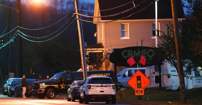 The Latest: Coroner: Vigil held outside Cincinnati nightclub