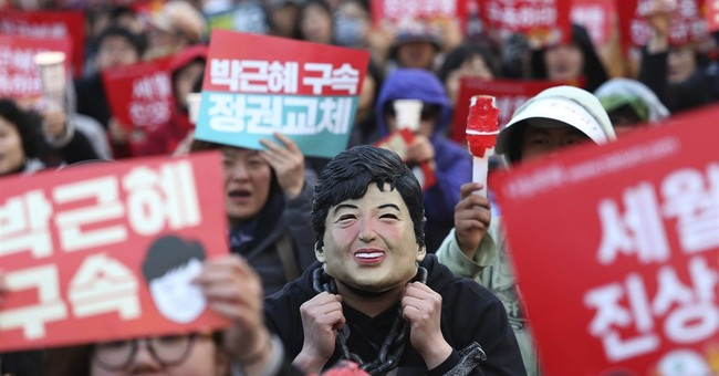 South Korean prosecutors push to arrest ousted president