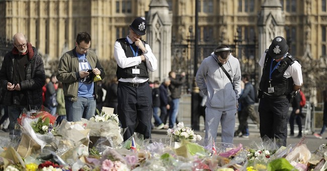 UK attacker's wife 'saddened and shocked'; security added