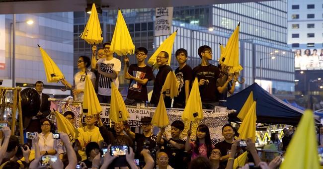 Hong Kong police arrest more 2014 democracy protest leaders