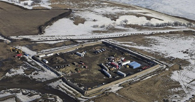 Company: Oil in pipeline under Missouri River reservoir
