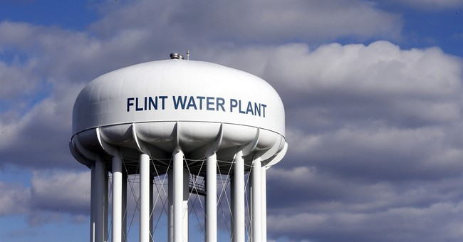 AP FACT CHECK: Obama, Trump had role in Flint water relief